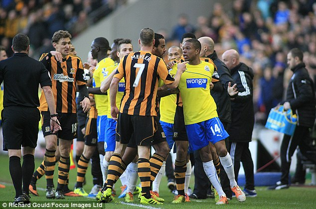 Heated: Tempers flair as players square up to each other after Pardew was sent to the stands