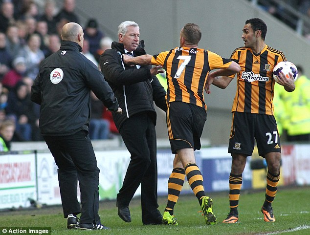 Arms raised: Hull midfielder Meyler pushes Pardew as the scenes get ugly on the touchline