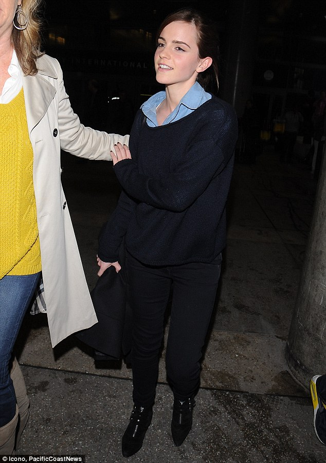 Hands off the merchandise! The Perks Of Being A Wallflower star appeared a little put off by being manhandled to her car by an overzealous publicist