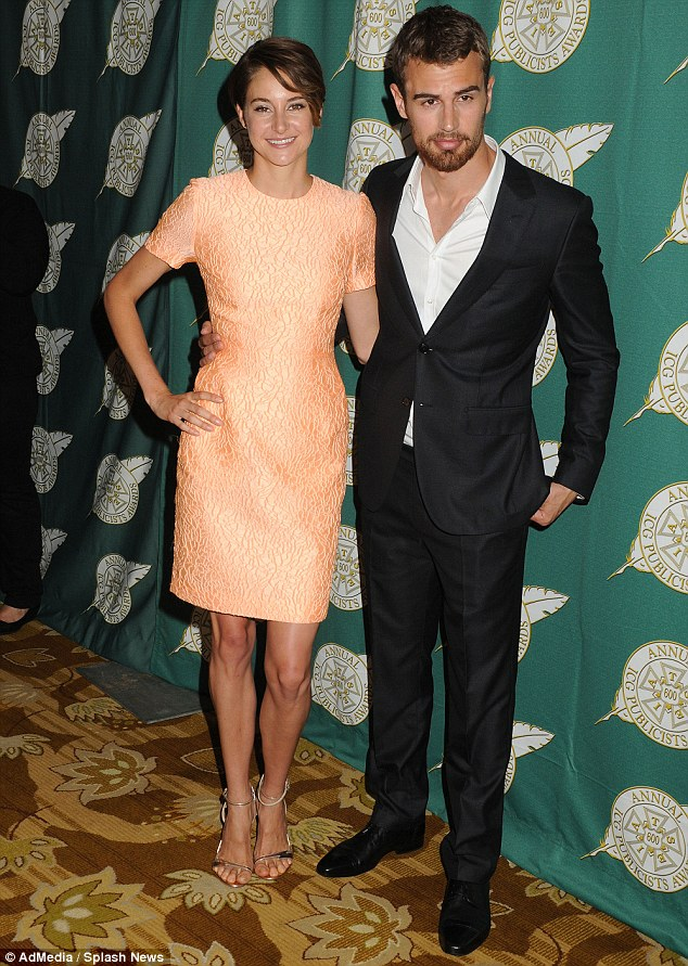 Quite the hunky companion: Shailene cuddled up to Divergent co-star Theo James