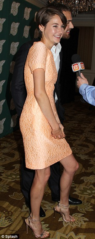 Long and leggy: The 22-year-old showed off fit figure in her short skirted frock