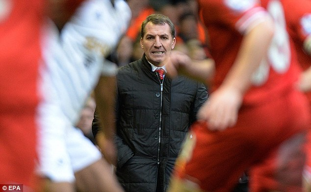 Encouragement: Brendan Rodgers has revealed the pep talks he gives to Suarez to get him going