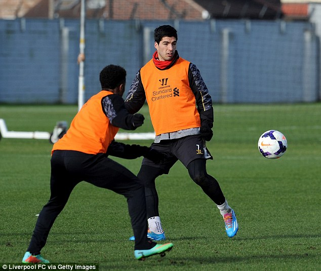 Doing his best: The Uruguayan in training this week along with winger Raheem Sterling