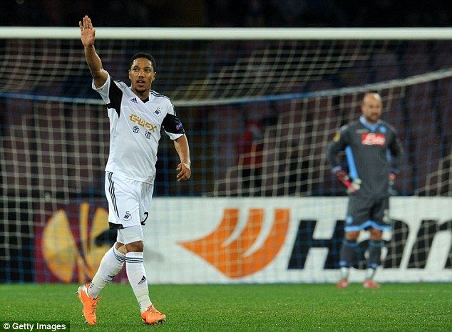 Brief hope: Jonathan De Guzman salutes the travelling fans after putting Swansea level at 1-1. They would have progressed on the away goals rule at that point