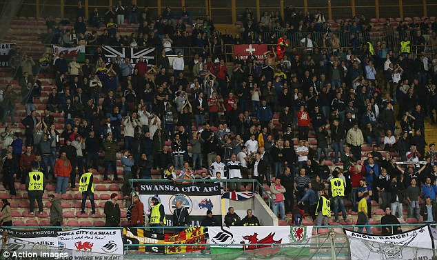 Delayed: 700 of the 900 travelling Swansea City fans in Naples were late in arriving at the Stadio San Paolo after buses failed to arrive in time