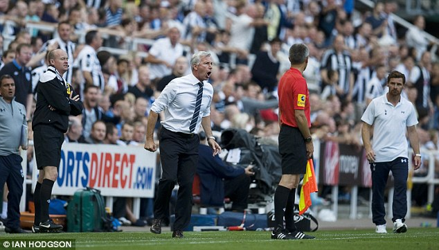 Spitting feathers: Pardew was banned for two matches after pushing a linesman against Tottenham in 2012
