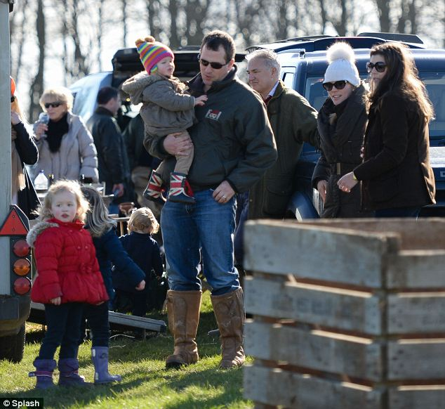 Family fun day: Peter takes the strain for a bit by carrying Isla as they move from stall to stall at the fair