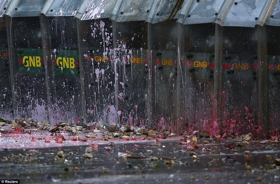 Debris: Stones and paint have been thrown against government barricades in Altamira Square, Caracas. Thousands have missed Carnival celebrations to protest