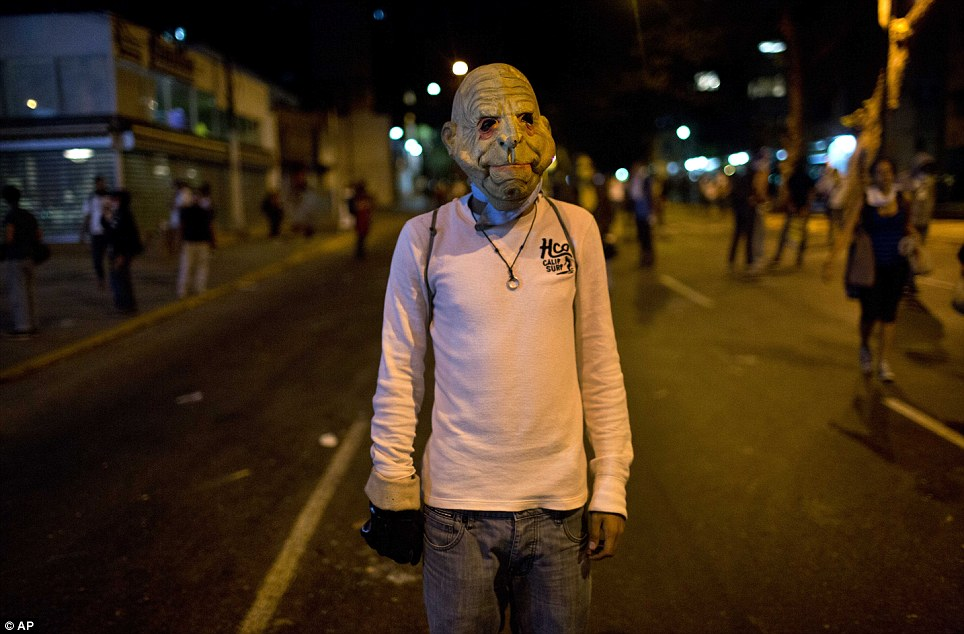 Horror show: The protesters have found their masks wherever they can, including at fancy dress shops. One said: 'There's not going to be peace until there's justice'