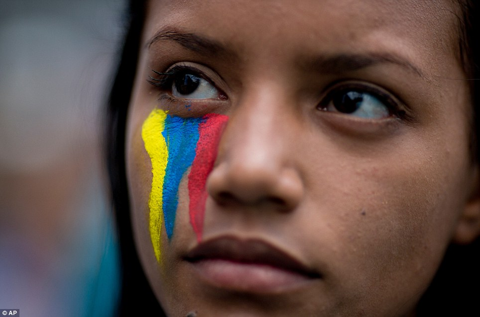 Pride: Amid the violence, Venezuelan authorities say they have arrested eight members of the domestic spy agency on murder charges, as well as three national guard soldiers and three police officers. 'The state... has acted to punish [those] responsible for human rights violations,' said chief prosecutor Ortega Diaz