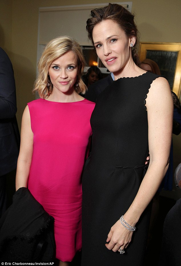 Beyond proud: Witherspoon and Gardner smiled for the camera as they partied away for the Oscar-nominated film