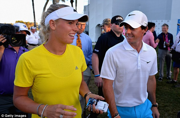Words of wisdom: McIlroy chats with fiance Caroline Wozniacki after finishing his round at the Honda Classic
