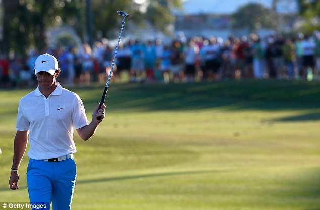 In front: Rory McIlroy acknowledges the crowd as he takes a two-shot lead into the final day