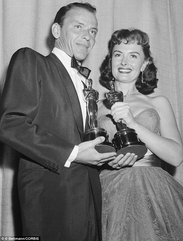 1954 ---Frank Sinatra and Donna Reed hold their Oscars after they were honored for their best supporting roles in From Here To Eternity