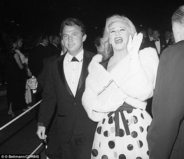 07 Apr 1965 --- An effervescent smile and a big wave came from actress Ginger Rogers as she arrived at the 37th annual Academy Awards presentations