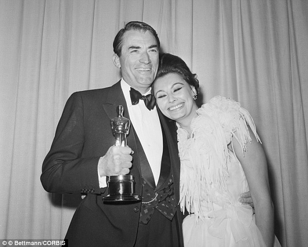08 Apr 1963--- Gregory Peck holds his Academy Award for Best Actor for 'To Kill a Mockingbird' while Sophia Loren puts her head on this shoulder. Loren had presented the Best Actor Oscar, as she had won for Best Actress the previous year