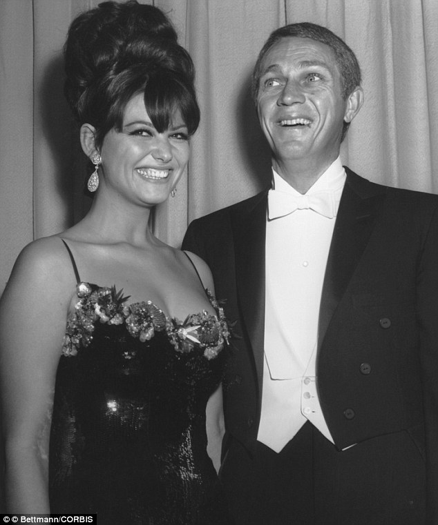 05 Apr 1965 --- Claudia Cardinale, who was completing a movie in Hollywood at the time, with actor Steve McQueen