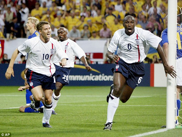 Back then: Campbell celebrates scoring against Sweden in the 2002 World Cup