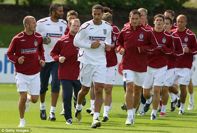 Leading the pack: Rio Ferdinand (front centre) is the only black player to be England's official leading captain