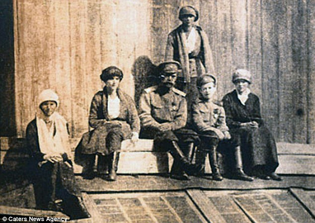 Final months: The Romanovs pictured during their exile in Tobolsk which lasted until April 1918