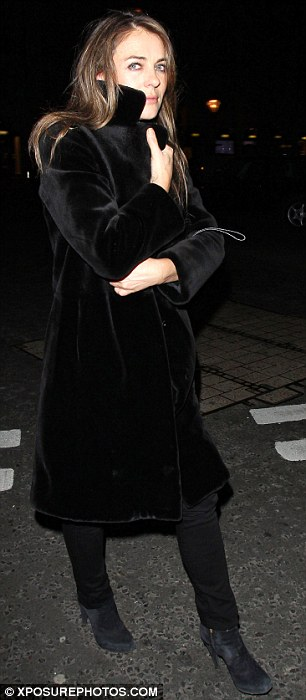 All black everything: Liz wore a black ensemble for her date night dinner with long-term friend Hugh