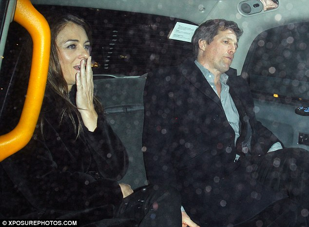 Tittering: Liz couldn't stop laughing as Hugh gave the driver their drop-off details