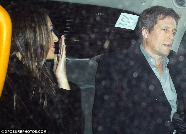 Something I said? Liz held her hand up to her mouth while Hugh looked unimpressed by her joke