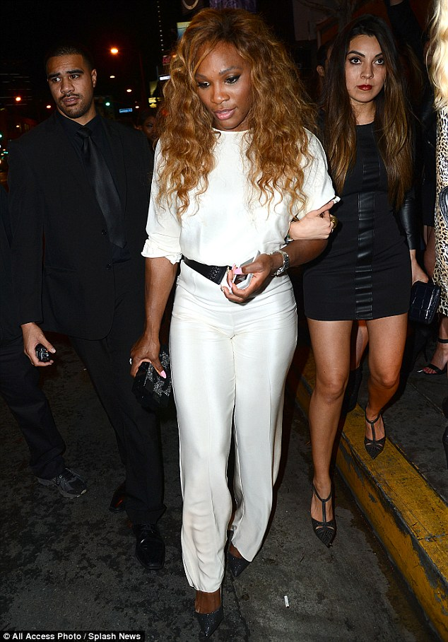 Hold on tight: Serena was joined by a female friend as they partied the night away