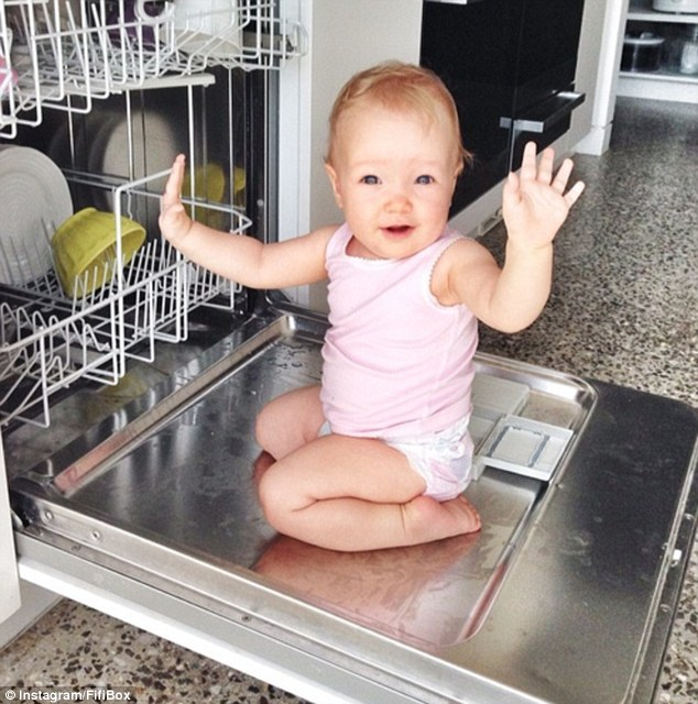 Caught in the act: Fifi Box's 10-month-old Trixie Belle thought playing in the dishwasher was a great idea on Sunday