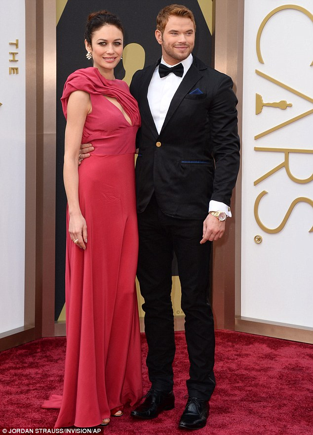 Eco glamour! Kellan Lutz wears a sustainable Eco-friendly tux as takes Bond girl Olga Kurylenko as his surprise Oscars date