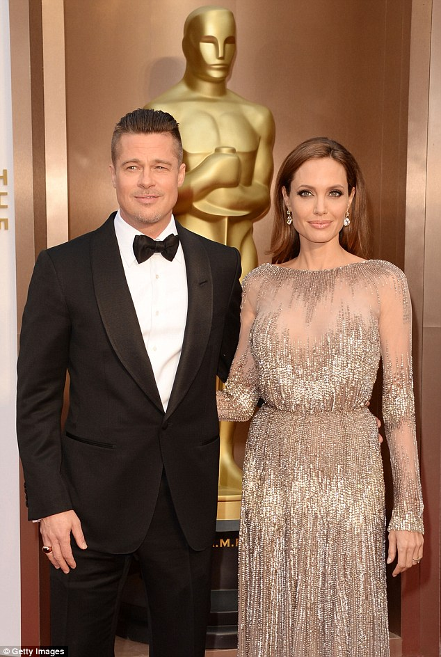 Star-studded: Brad Pitt and Angelina Jolie were expected to attend Madonna's party, pictured at the Oscars on Sunday