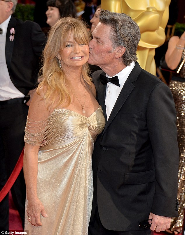 A red carpet kiss for Goldie: The star, who once insisted she doesn't believe in marriage, is given a cheeky kiss for the cameras by partner Kurt Russell as they arrive at the Oscars