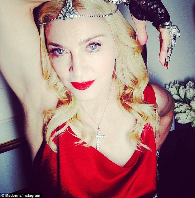 Material Girl: Madonna wore 1,000 carats of diamond to her annual Oscars after-party on Sunday in Los Angeles