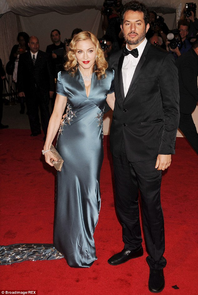 Her main man: The party is always held at Madonna's manager Guy Oseary's mansion in LA, pictured together in NYC in 2011
