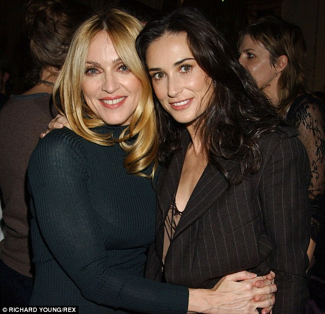 Back in the day: Madonna and Demi Moore used to co-host the party together, but Madonna chose Demi's ex-husband Ashton over her friend, pictured in the UK in 2004