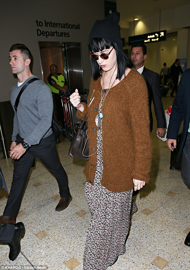 Prism promoting: Katy Perry arrived at Sydney airport on Tuesday morning - she's come Down Under to promote her Prismatic World Tour