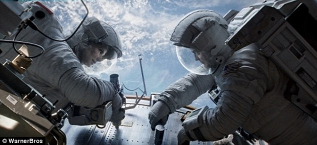 Sweeping the board: Gravity took its fifth Oscar, for editing, and te honour went to director Alfonso Cuaron and British colleague Mark Sanger