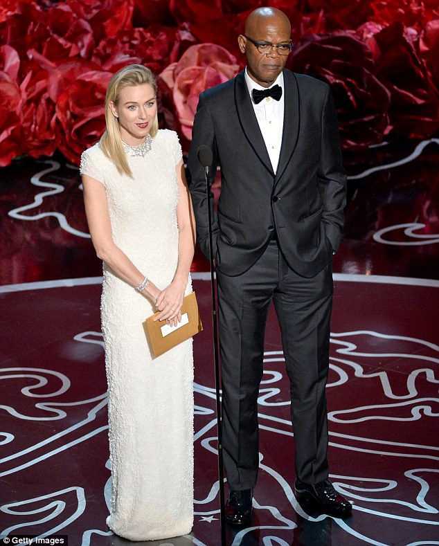 Presenting duo: Naomi Watts looked stunning in a Calvin Klein dress as she joined Samuel L. Jackson onstage