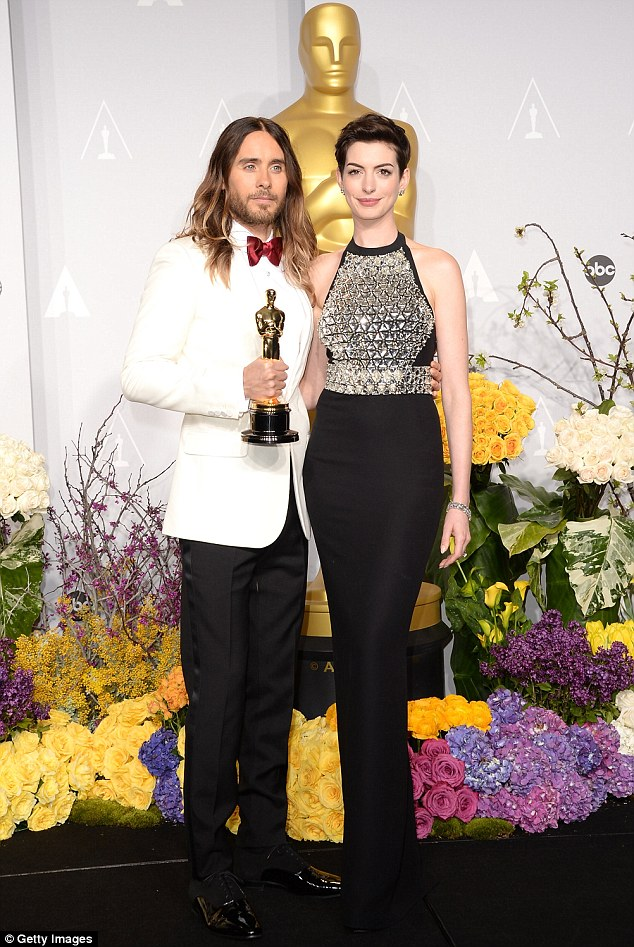 Posing like statues: Jared and Anne pose backstage after she gave out the award for Best Supporting Actor