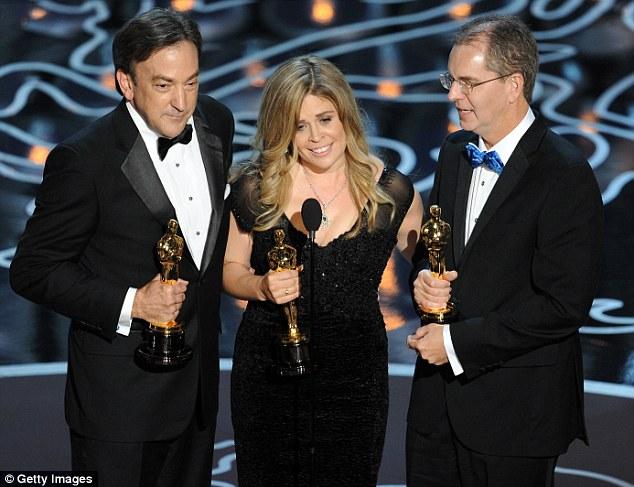 Triple win: Producer Peter Del Vecho, directors Jennifer Lee and Chris Buck accept the Best Animated Feature Film award for Frozen onstage during the Oscars at the Dolby Theatre