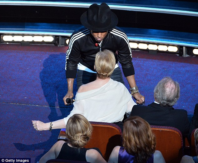 Twerk with me, Meryl! Pharrell manages to get Streep to shimmy along with him while he performed at the bash