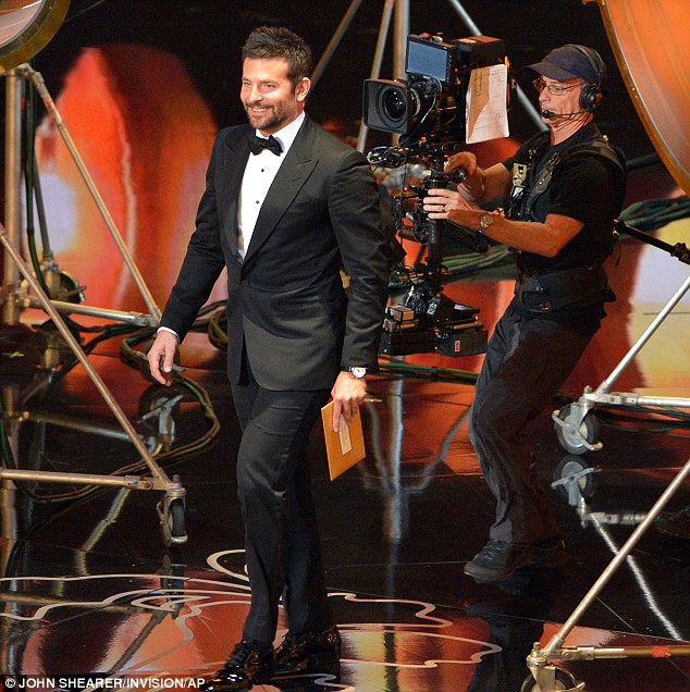 Missing out: While Bradley Cooper didn't win for Best Supporting Actor... Ellen did offer him a scratch card instead