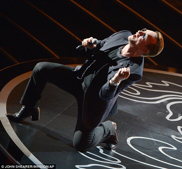 Rocking out: Bono of U2 performs Ordinary Love as they honoured Nelson Mandela at the event