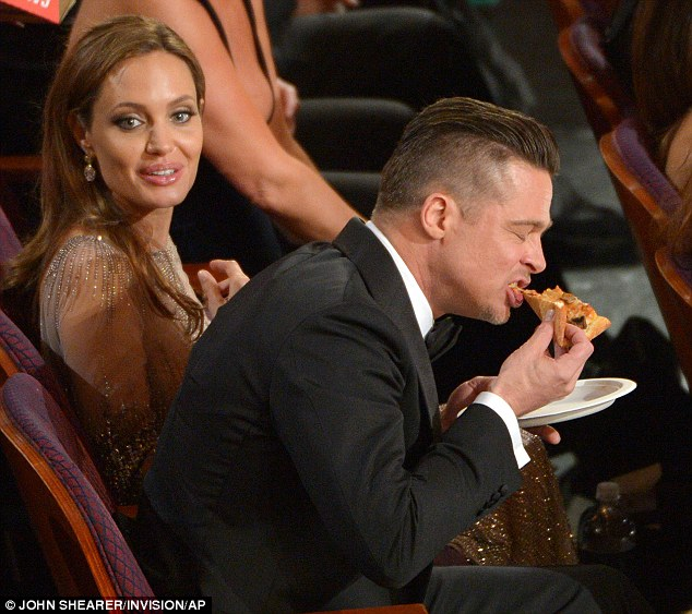 None for you, Angelina? Brad was seen tucking into a large slice of pizza dished out by host Ellen