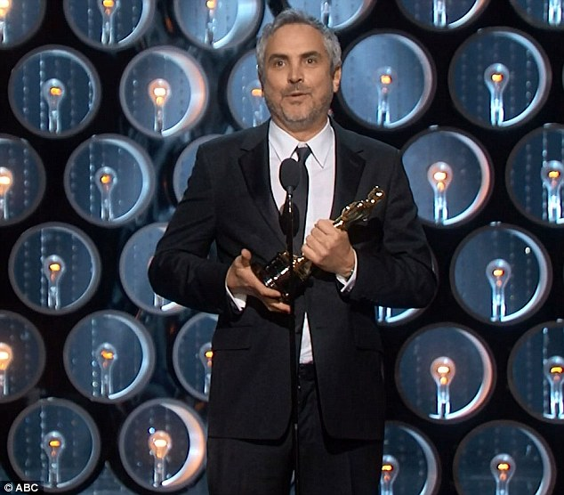 Gracious: Alfonso Cuarón accepts his Best Director Award for Gravity