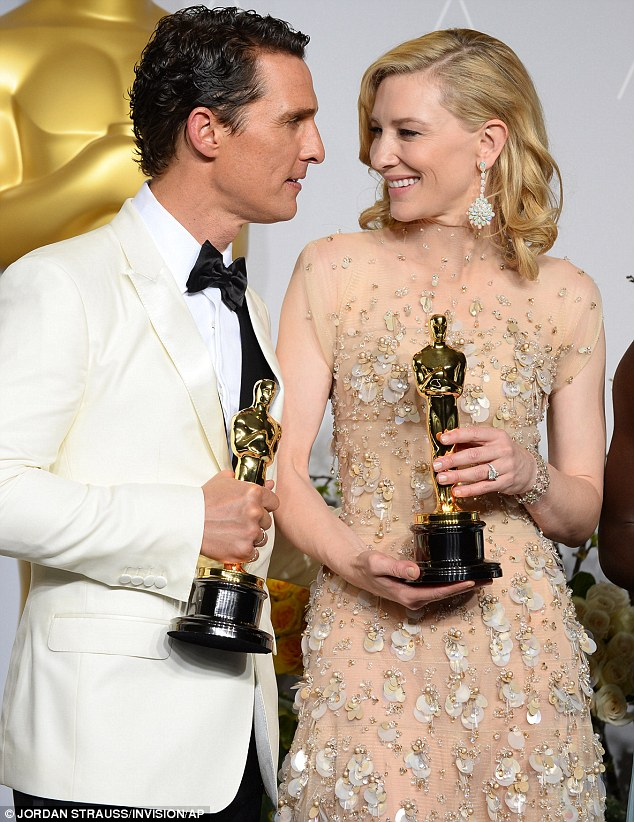Golden duo: Matthew and Cate share an intimate moment together backstage at the event