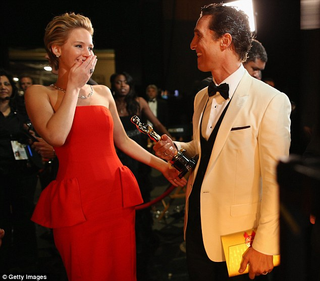 Cheeky: Matthew tickled Jennifer Lawrence with a cheeky remark after she presented him with the Best Actor Award