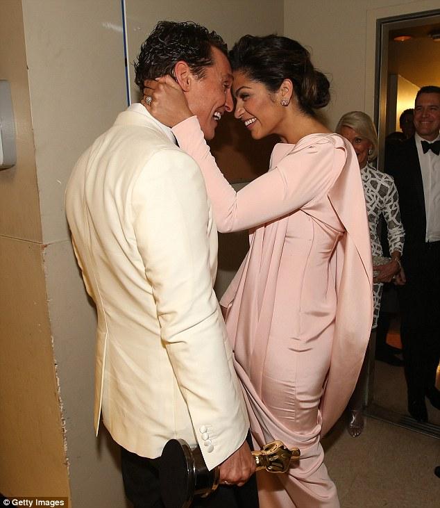 Proud: Camila Alves looks ecstatic as she congratulates husband Matthew on his win backstage
