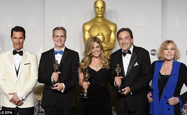 Winners: Filmmakers Chris Buck, Jennifer Lee and Peter Del Vecho hold their Oscars for Best Animated Feature Film for Frozen while standing with Matthew McConaughey and Kim Novak