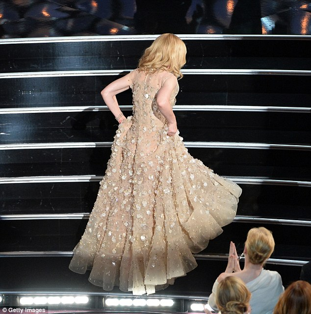 Steady on her feet: Cate managed to stay upright unlike Jennifer Lawrence as she ascended the Oscars stage to accept the Best Performance by an Actress in a Leading Role award for Blue Jasmine